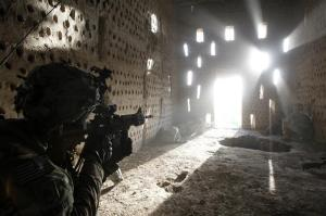 U.S. soldier Nicholas Dickhut from 5-20 infantry Regiment attached to 82nd Airborne points his rifle at a doorway after coming under fire by the Taliban while on patrol in Zharay district in Kandahar province, southern Afghanistan April 26, 2012. REUTERS/Baz Ratner (AFGHANISTAN - Tags: MILITARY TPX IMAGES OF THE DAY)