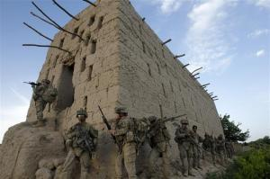 U.S. soldiers from 5-20 infantry Regiment attached to 82nd Airborne enter a barn while on patrol in Zharay district in Kandahar province, southern Afghanistan April 26, 2012. REUTERS/Baz Ratner (AFGHANISTAN - Tags: MILITARY)